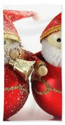 Two Father Christmas Decorations Beach Towel