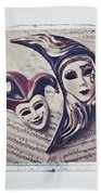 Two Masks On Sheet Music Beach Towel