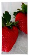 Two Strawberries On A Glass Plate Beach Towel