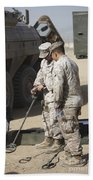 Two U.s. Marines Use A Mine Detector Beach Towel