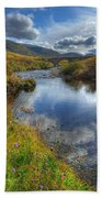 Upstream To The Bridge Beach Towel by John Kelly