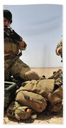 U.s. Air Force Soldiers Gather Beach Towel
