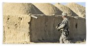 U.s. Army Soldier Conducts A Dismounted Beach Towel