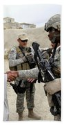 U.s. Army Soldier Shakes Hands With An Beach Towel