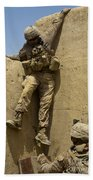 U.s. Marine Climbs Down From An Beach Towel