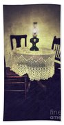 Vintage Table And Chairs By Oil Lamp Light Beach Towel
