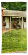 Waiting By The General Store Beach Towel by Paul Ward