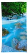 Water Rushing Through Rocks Beach Towel