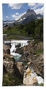 Waterfall At Many Glacier Beach Towel