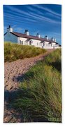 Welsh Cottages Beach Towel by Adrian Evans