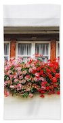 Windows With Red Flowers Beach Towel