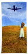 Woman In Field Looking Up At An Airplane Beach Towel