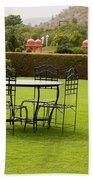 Wrought Metal Chairs Around A Table In A Lawn Beach Towel