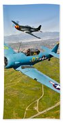 A T-6 Texan And P-51d Mustang In Flight Beach Towel