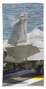 An Fa-18f Super Hornet Taking Off Beach Towel