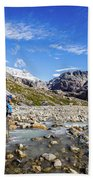 Crossing A River In Patagonia Beach Towel