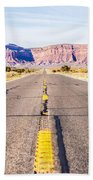 descending into Monument Valley at Utah  Arizona border  Beach Towel