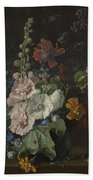 Hollyhocks And Other Flowers In A Vase Beach Towel