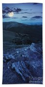 Light On Stone Mountain Slope With Forest At Night Beach Towel