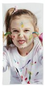 Little Girl Covered In Paint Making Funny Faces. Beach Towel