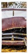 Old Vintage Plymouth Automobile In The Woods Covered In Snow Beach Towel