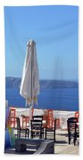 Restaurant By The Aegean Sea  In Santorini, Greece  Beach Towel