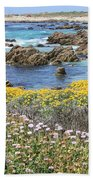 Rocky Surf With Wildflowers Beach Towel