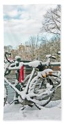 snowy Amsterdam in the Netherlands Beach Towel