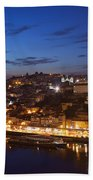 City Of Porto In Portugal By Night Beach Towel
