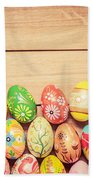 Colorful Hand Painted Easter Eggs On Wood Beach Towel