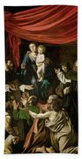 Madonna Of The Rosary Beach Towel by Caravaggio