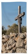 Rosary Hanging On A Small Wooden Cross On A Stone Wall Beach Towel