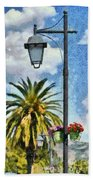 Lampost With Flowers In Nafplio Town Beach Towel