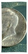 Coin Containing Silver Inhibits Beach Towel