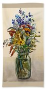 A Bouquet Of Wild Flowers In A Glass Jar. Beach Towel