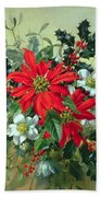 A Christmas Arrangement With Holly Mistletoe And Other Winter Flowers Beach Towel