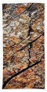 A Crack On A Brown Stone Block Beach Towel