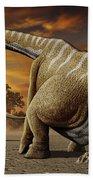 A Female Apatosaurus Laying Her Eggs Beach Towel
