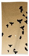 A Flight Of Grackles Circling The Moon Beach Towel