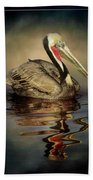 A Pelican And His Reflection Beach Towel