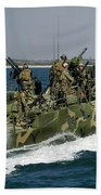 A Riverine Command Boat Conducts Beach Towel