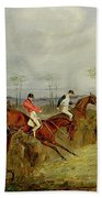A Steeplechase - Taking A Hedge And Ditch  Beach Towel by Henry Thomas Alken