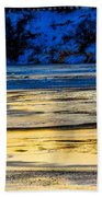 A Sunset In A River Of Ice Beach Towel