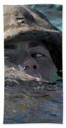 A U.s. Marine Swims Across A Training Beach Sheet