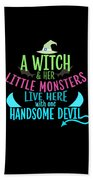 A Witch And Her Little Monsters Live Here With One Handsome Devil Halloween Beach Towel