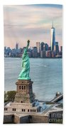 Aerial Of The Statue Of Liberty At Sunset, New York, Usa Beach Towel