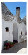Alberobello Courtyard With Trulli Beach Towel