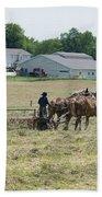 Amish Girl Raking Hay Photo Beach Towel