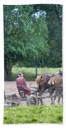 Amish Lady Disking Beach Towel