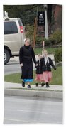 An Amish Family Going For A Walk Beach Towel